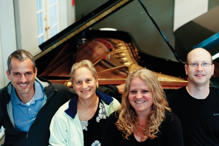 Annual 'two pianos, eight hands' piano concert is a game of musical chairs